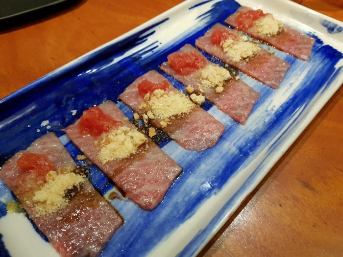 O toro sashimi with pan con tomate