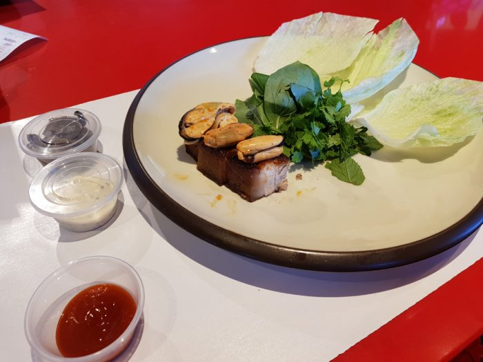 Grilled iberian pork pancetta SAAM - Marinated mussel condiment, pickled shiitake mushrooms, sriracha and tartar XO-sauce