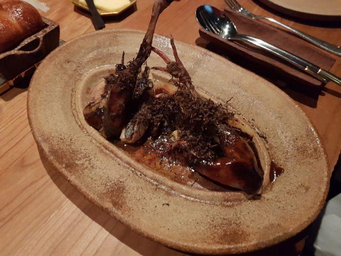 barbecue of quail, pear, endive, sauce périgueux
