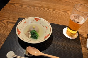 Dumpling of soba dough filled with fatty pig in a clear broth
