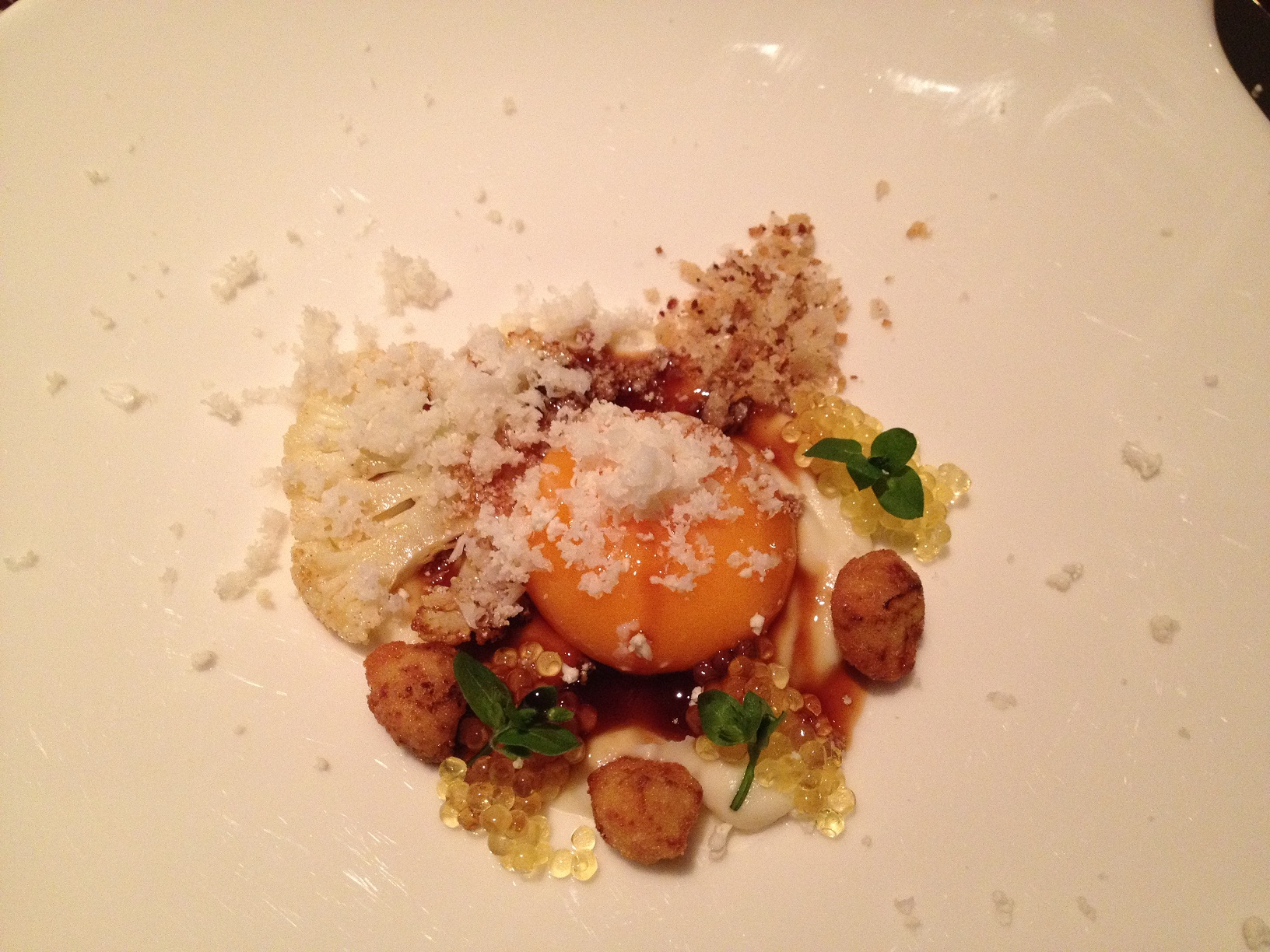 Waxy yolk on cream of cauliflower, with baked and raw cauliflower and char caviar