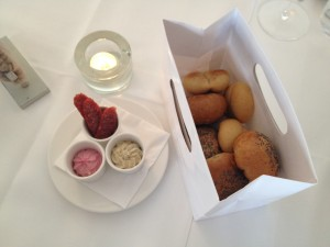 Gut Purbach: Table setting with mini rolls, beetroot/pumpkin spread and boar sausage