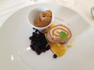 Chocolate roll with mocca ice-cream and pickled fruits