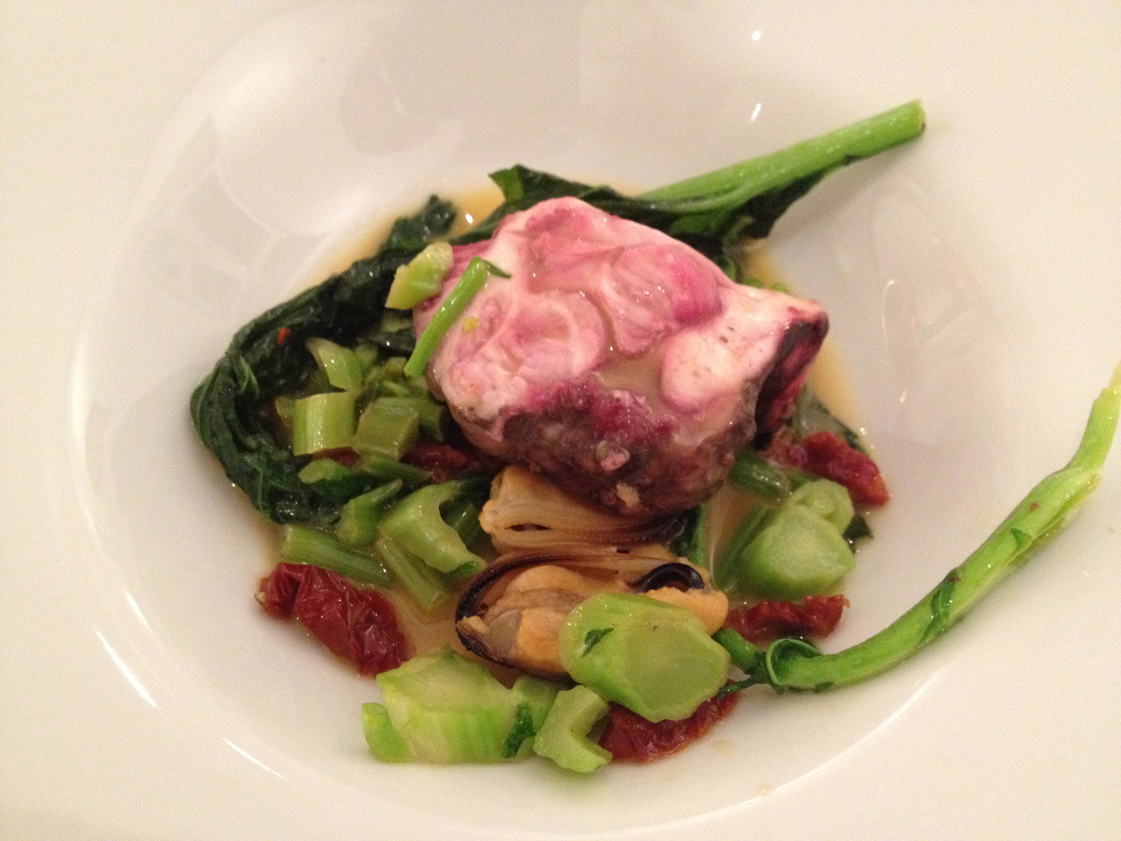Poached calf brain on mussels and wild broccoli