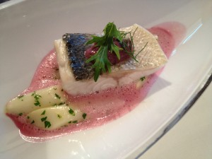 Sea bass with asparagus from Eferding, caper-cabbage-paste and elder-red cabbage-sauce