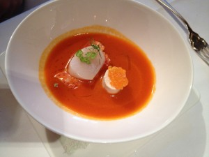 Cold sweet pepper-seabuckthorn soup with smoked trout, scallop and lobster