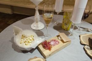 Amuse bouche one - Caramelized popcorn, prosciutto, salami, lardo
