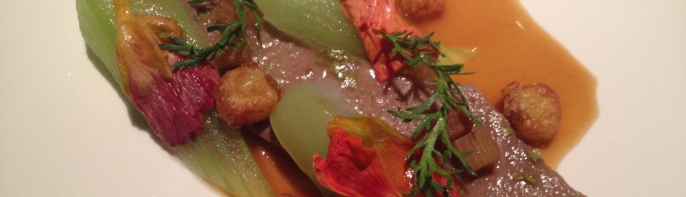 Braised veal's tongue with rhubarb, salted plums and nasturtium